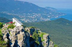 Mountain cableway. Hight mountains and warm summer sea Royalty Free Stock Image