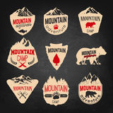 Mountain camp badges templates with mountains and trees isolated royalty free illustration