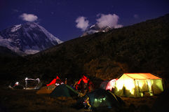 Mountain camping at night. A view of lights shining through tents at night in the mountains of Cordilliera Blanca, in the Peruvian Andes Stock Photo