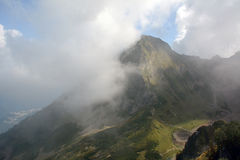 Mountain in the Caucasus with the cloud in the front. Royalty Free Stock Images