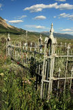 Mountain Cemetery. Cemetery in the mountains overgrown with grass and wildflowers on a summer day royalty free stock images