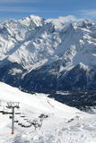 Mountain chairlift. Ski lift under high mountains. Alps of France, Contamines Montjoie Royalty Free Stock Photography