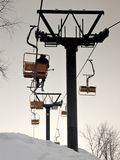 Mountain chairlift: the last skier. Chairlift with one skier Stock Image