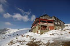 Mountain chalet. Dochia chalet on mountain in winter, Romanian Carpathians Stock Images