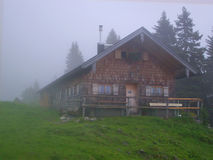 Mountain chalet in fog Stock Photos
