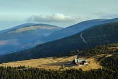Mountain chalet on the meadow Stock Photography