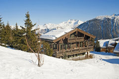 Mountain chalet in the snow stock image