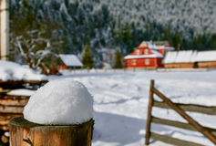 Mountain chalet in the snow landscape Stock Image