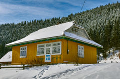 Mountain chalet in the snow landscape Royalty Free Stock Photo