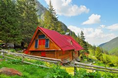 Mountain chalet with solar panels Stock Photography