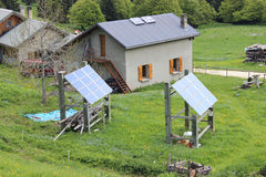 Mountain chalet with solar panels Royalty Free Stock Photos