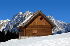 Mountain chalet in winter - Italy Alps Royalty Free Stock Images