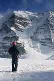 Mountain challenge. Mountaineering in the Alps - Ice climbing royalty free stock photography