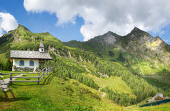 Mountain chapel in the alps Stock Photography