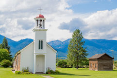 Rustic mountain chapel and cabin in Montana Royalty Free Stock Image
