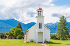 Rustic mountain chapel with cabins in Montana Stock Images