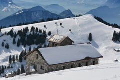 Mountain Chapel Regina Montium. This is the beautiful old stone church called Regina Montium (Latin: Queeen of the Mountains) on top of the mount Rigi in Stock Images
