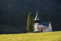 Mountain chapel with sunshine Royalty Free Stock Images