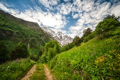 Mountain Cheget and snow-capped peaks of Mount Donguzorun Stock Photo