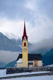 Mountain church. A wintertime view of a small church with a tall steeple in the mountainous region of Sud, Tyrol, Italy royalty free stock images