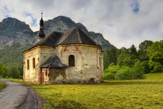 Mountain church. Dilapidated church in a mountain valley in the Alps Royalty Free Stock Photography