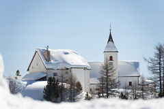Mountain church in winter. On sunny day Royalty Free Stock Images
