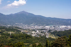 Mountain and city area Stock Images