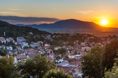 Mountain city seen from above at sunset. Mountain city Brasov seen from above Tampa Peakl at sunset Stock Photography
