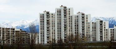 Mountain city. A string of apartment buildings over a mountain background Stock Photos