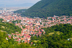 Mountain cityscape. Cityscape of old part from Brasov, city between mountains in Romania Stock Images
