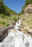Mountain clean water flowing down a stream. Royalty Free Stock Photography
