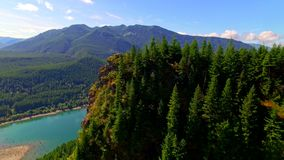 Mountain cliff by a blue lake stock video footage