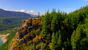 Mountain cliff by a blue lake stock footage
