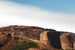 Mountain cliff of red brown colored chinese soil agriculture landscape. Mountain cliff of red brown colored chinese soil agriculture landscape in the morning Royalty Free Stock Photography