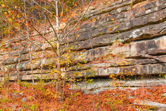 Mountain cliff with rock layers, colorful stone formations of ro Royalty Free Stock Photo