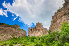Mountain cliffs and cloudy sky Stock Photography
