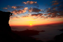 Mountain climb silhouettes with sunset background Royalty Free Stock Photography