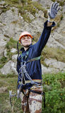 Mountain climber. Young mountain climber with his hand outstretched stock image