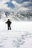 Mountain climber. A man walks in the mountains in winter stock photos