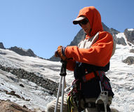 Mountain climber. Young mountain climber prepairing to go glacier Royalty Free Stock Photography