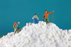 Mountain climber figures on flour Royalty Free Stock Photo