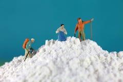 Mountain climber figures on flour Royalty Free Stock Photo