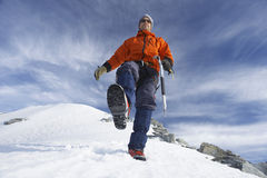 Mountain Climber Hiking On Snowy Slope Stock Image