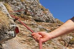 Mountain climber holding on a climbing rope. Hand of mountain climber, holding on a climbing rope stock photos