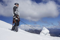 Mountain Climber On Snowy Slope With Safety Line Attached Royalty Free Stock Photo