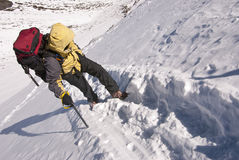 Mountain climber on snowy slope Royalty Free Stock Photography