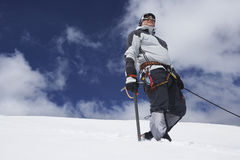 Mountain Climber On Snowy Slope With Safety Line Attached Stock Images