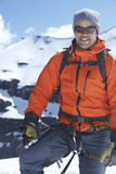Mountain Climber Standing Against Snowy Mountains Royalty Free Stock Image