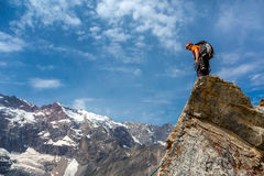 Mountain climber on top Stock Images