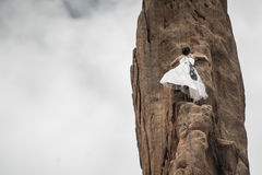 Mountain climber in white dress